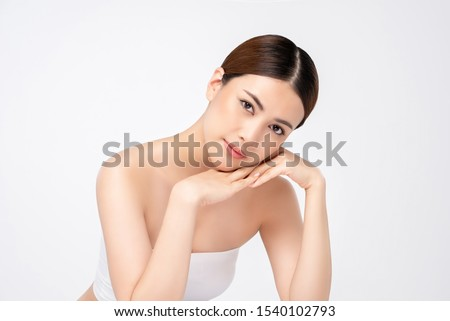 Youthful pretty Asian woman with hands touching face isolated on white background for beauty and skincare concepts