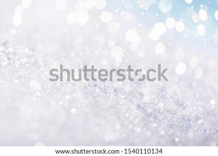 Chritmas light background with snow and blue sky. Design background #1540110134