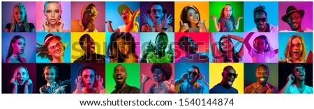 Close up portrait of young people in neon light. Human emotions, facial expression. People, astonished, screaming and crazy in happiness. Creative bright collage made of different photos of 17 models. #1540144874