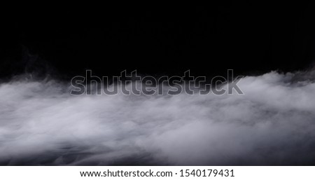 Realistic dry ice smoke clouds fog overlay perfect for compositing into your shots. Simply drop it in and change its blending mode to screen or add. Royalty-Free Stock Photo #1540179431