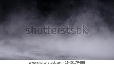 Realistic dry ice smoke clouds fog overlay perfect for compositing into your shots. Simply drop it in and change its blending mode to screen or add. Royalty-Free Stock Photo #1540179488
