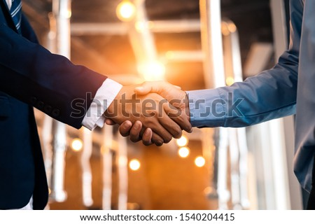 Business shaking hands, finishing up meeting. Successful businessmen handshaking after good deal. #1540204415