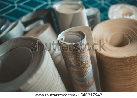 Various wallpapers rolls. Different textures and colours.  #1540217942
