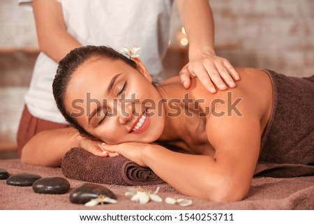 Young woman having massage in spa salon #1540253711