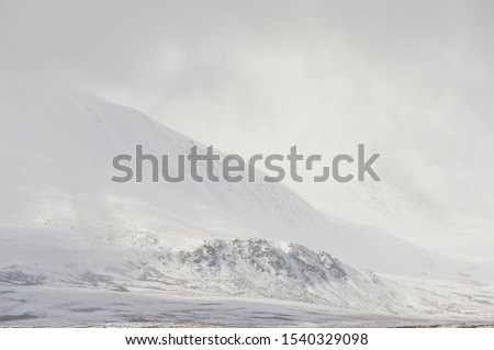 Winter landscape. Dramatic overcast sky.Severe mountains peaks covered by snow. Russia, Siberia, Altai mountains, Chuya ridge. #1540329098