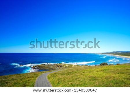 Australian coastal walk and sand beach at Coffs Harbour #1540389047