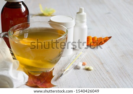 Various medications and hot tea with lemon. Treatment of colds and flu #1540426049