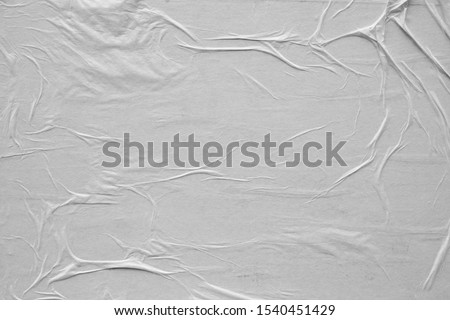 Blank white crumpled and creased paper poster texture background. Background for designers. Royalty-Free Stock Photo #1540451429