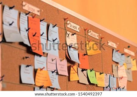 Close up task board, scrum, office bulletin board, agile stickers. Using tasks control of agile development methodology. Kanban board is one of tools of agile work methodology #1540492397