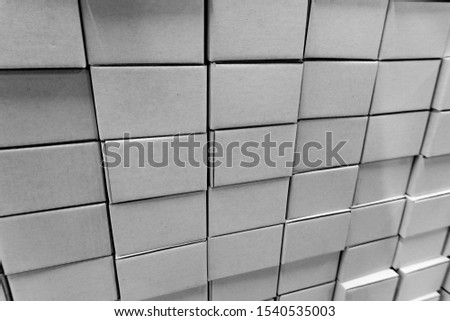 Isolated close-up of stacked wall made of multiple blank white closed rectangular cardboard boxes, used for delivering consumer goods. Symbol of packaging efficiency and global trade. #1540535003