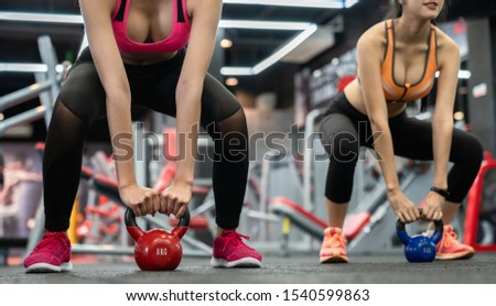 Two Young Asian women push-ups on kettle ball in crossfit gym. #1540599863