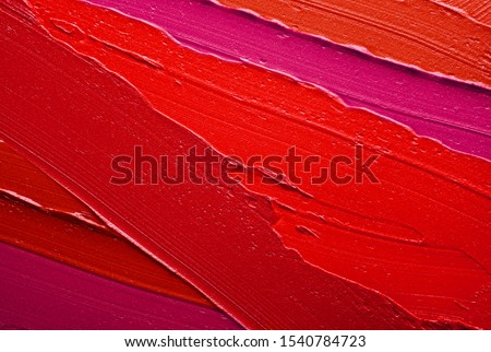 Lip gloss pink red smudge background