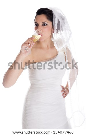 a beautiful bride posing on her wedding day #154079468