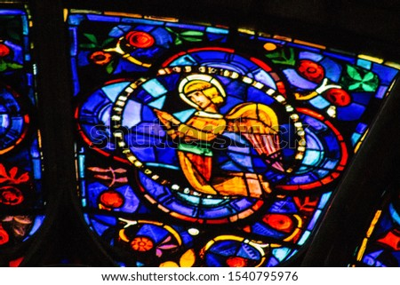 Reims France October 24, 2019 Closeup of stained glass windows inside the Notre Dame Cathedral in the afternoon #1540795976