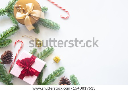 Holiday Christmas card background with festive decoration ball, stars, snowflakes, gift box, pine cones on a white background from Flat lay, top view. Space for text Merry Christmas and happy New Year #1540819613