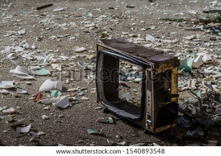 Old empty tv on the floor with broken glass #1540893548