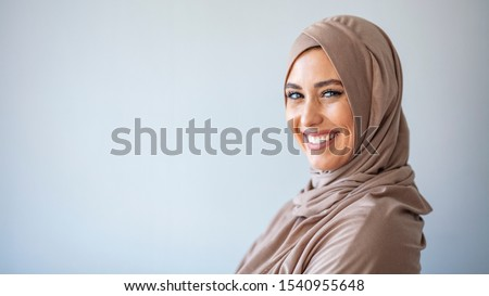 Young asian muslim woman in head scarf smile. Beautiful middle eastern woman wearing abaya. Arabian woman with happy smile. Strict formal outfit and elegant appearance. Islamic fashion. #1540955648