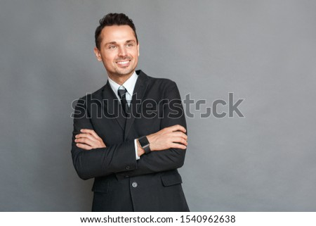 Business man studio standing isolated on grey wall crossed arms looking aside smiling cheerful #1540962638