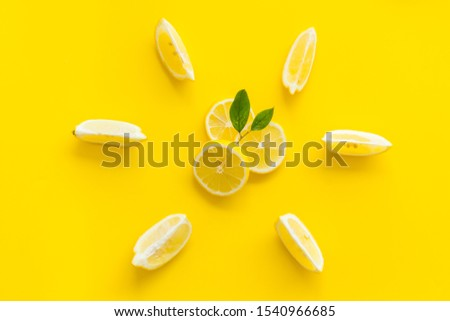 Lemon pattern on yellow background top view #1540966685