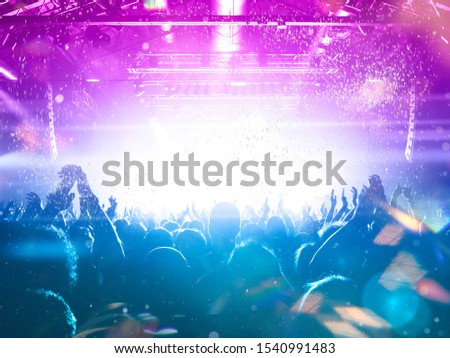 Colourful concert arena with a crowd silhouette against stage lights #1540991483
