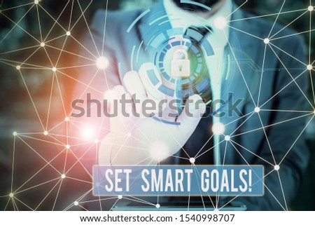 Writing note showing Set Smart Goals. Business photo showcasing list to clarify your ideas focus efforts use time wisely Picture photo network scheme with modern smart device. #1540998707