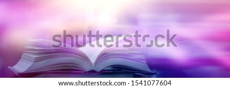 Imagine a picture book of an ancient book opened on a wooden table with a sparkling golden background. With magical power, magic, lightning around a glowing glowing book In the room of darkness #1541077604