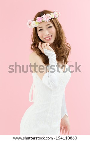 Beautiful young woman in a wedding dress #154110860