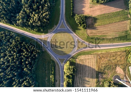 Roundabout, aerial view. Road infrastructure. Sunny summer day. View vertically from top to bottom. #1541111966