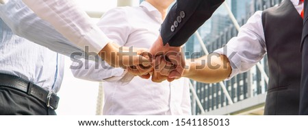 Close up on hands of business people join together on unity concept #1541185013