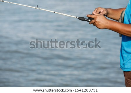 Fishing with rod on tropical summer sea.  #1541283731