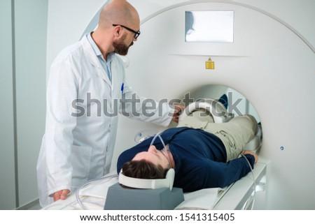 Patient visiting MRI procedure in a hospital #1541315405
