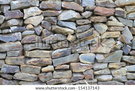 The wall combined from a wild raw stone #154137143