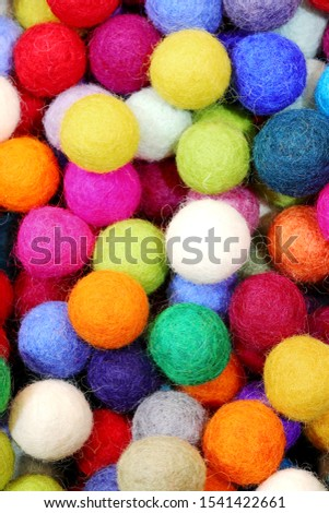 background of felt balls for sale as christmas ornaments #1541422661