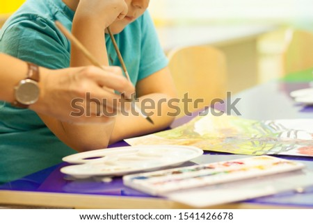 A lesson in watercolor painting for preschool children #1541426678