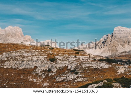 Monte Piana and Monte Piano, Toblach, South Tyrol / Italy - October 2019 : Panoramic view from summit of Monte Piana with Rifugio Lavaredo visible in the very far distance  #1541513363