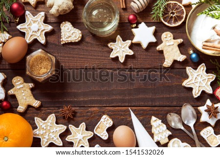 Making gingerbread cookies with ingredients on wooden background #1541532026