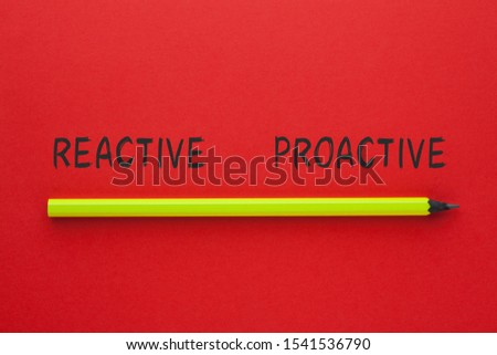 The words Reactive Proactive and pencil on red background. Business concept. #1541536790