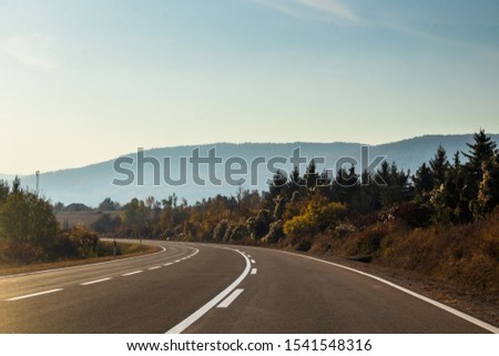 Sunrise on mountain road at autumn. Road by the Rtanj mountain in Serbia. #1541548316