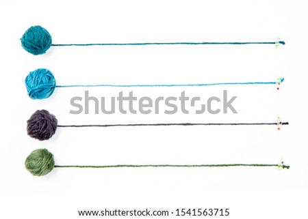 Background of wool yarn, knitted yarn, can also be used as a yarn frame. Knitting yarn for handicrafts isolated on white background. #1541563715