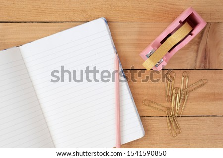 Feminine workplace concept. Freelance fashion comfortable femininity workspace in flat lay style with flowers, golden pineapple, notebook on white marble background. Top view, bright, pink and gold #1541590850