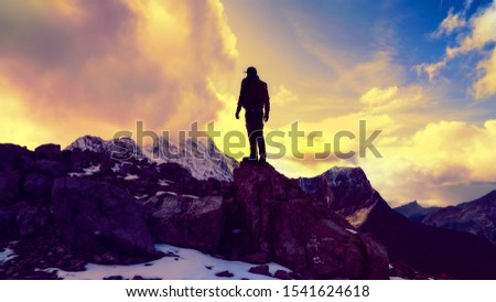 Dramatic Man Standing On Top Of Mountain Peak Success Concept  #1541624618