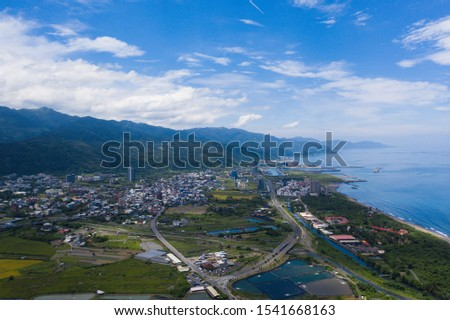The aerial view of water paddy field with sunny day and blue sky. Taiwan Ilan. The river cross the paddy field. #1541668163