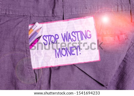 Text sign showing Stop Wasting Money. Conceptual photo advicing demonstrating or group to start saving and use it wisely Writing equipment and white note paper inside pocket of man work trousers. #1541694233