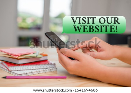 Writing note showing Visit Our Website. Business photo showcasing visitor who arrives at web site and proceeds to browse woman using smartphone and technological devices inside the home. #1541694686