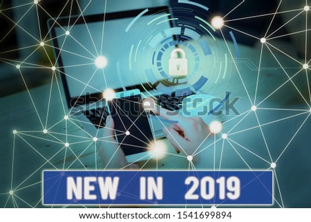 Conceptual hand writing showing New In 2019. Business photo text what will be expecting or new creation for the year 2019 Picture photo network scheme with modern smart device. #1541699894