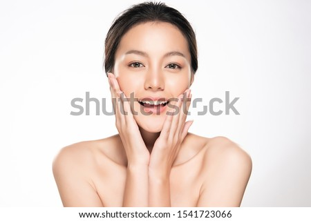 Beautiful young Asian woman touching soft cheek and smile with clean and fresh skin. Happiness and cheerful with, isolated on white background, Beauty and Cosmetics Concept, #1541723066