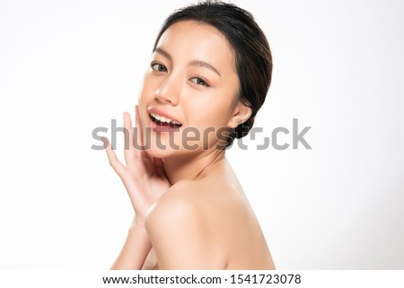 Beautiful young Asian woman touching soft cheek and smile with clean and fresh skin. Happiness and cheerful with, isolated on white background, Beauty and Cosmetics Concept, #1541723078