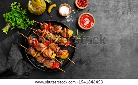 Kebabs - grilled meat skewers, shish kebab with vegetables on black wooden background. #1541846453