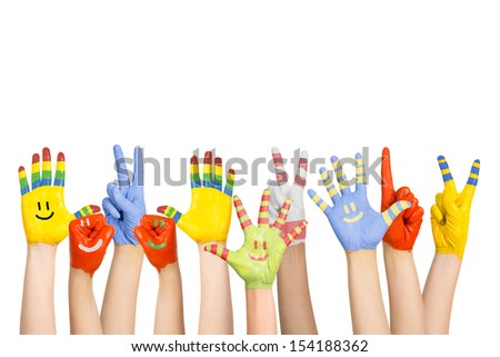 painted children's hands in different colors with smilies #154188362
