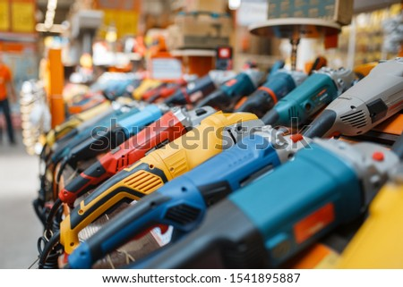Hardware store assortment, angle grinders Royalty-Free Stock Photo #1541895887